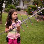 Girl holding an antenna